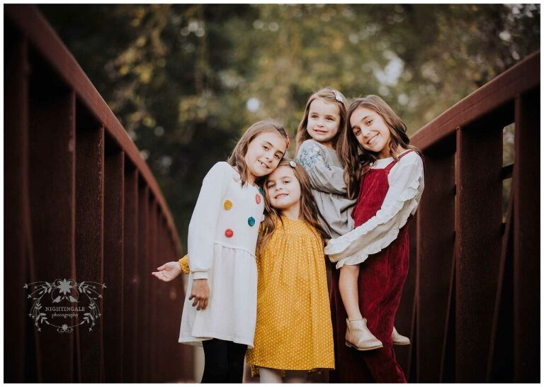 This rustic red bridge was the perfect location for this sweet family picture in Danville, Ca by Nightingale Photography